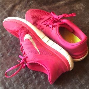 Hot pink Nike Free 4.0 running shoes
